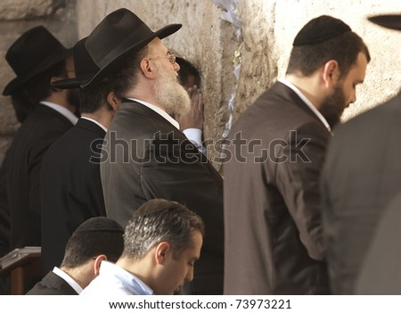 JERUSALEM - APRIL 4: Unidentified Hebrew Orthodox group praying at the Wailing Wall on April 4, 2008 in Jerusalem. - stock photo