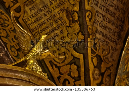 JERUSALEM - CIRCA 2012:Bird sculpture made of gold, above the Altar of the Crucifixion. at the Church of the Holy Sepulchre in the old city of Jerusalem, Israel, on Circa 2012. - stock photo