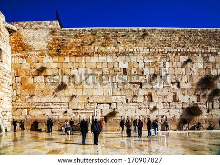 JERUSALEM - DECEMBER 15: The Western Wall in the night on December 15, 2013 in Jerusalem. It's located in the Old City of Jerusalem at the foot of the western side of the Temple Mount. - stock photo