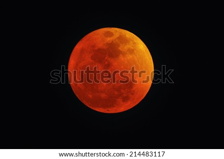 JERUSALEM, ISR - APRIL 15 2014:Blood Red Moon during Lunar eclipse.It was the first of four consecutive total eclipses in a series, known as a tetrad eclipses (Oct 8 2014, Apr 4 2015 and Sep 28, 2015. - stock photo