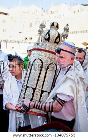 JERUSALEM, ISRAEL - APRIL 26: Jewish with the Torah, ancient scrolls at the western wall on a jewish holiday Israel's 64th Independence Day on April 26, 2012 in Jerusalem, Israel - stock photo