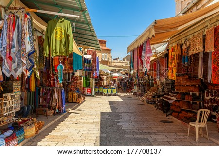 JERUSALEM, ISRAEL - AUGUST 21, 2013: Bazaar in Old City offers middle east traditional products and souvenirs. It is very popular with locals, tourists and pilgrims visiting Jerusalem, Israel. - stock photo
