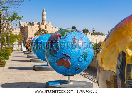 JERUSALEM, ISRAEL - AUGUST 21, 2013: 18 big globes exposed in Old City of Jerusalem as part of Cool Globes project show ideas for solutions and raise awareness for the problem of global warming. - stock photo
