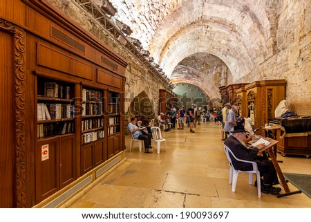 JERUSALEM, ISRAEL - AUGUST 21, 2013: Prayers and visitors inside of Cave Synagogue which is a part of Western Wall (aka Wailing Wall) - Judaism's holy place located in Jerusalem, Israel. - stock photo