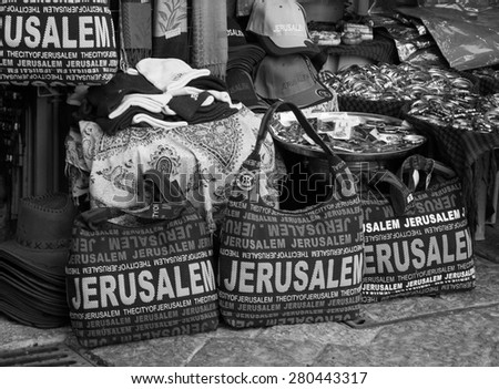JERUSALEM, ISRAEL - FEBRUARY 19, 2014: Bags and hats with JERUSALEM  inscription for sale at the market in the Old City of Jerusalem. Old City market is very popular tourist attraction. - stock photo
