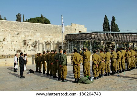 JERUSALEM, ISRAEL - FEBRUARY 13 :   Soldiers of Israel defense force arrived at the Western Wall. Briefing before the prayer on February 13, 2012 in Jerusalem, Israel - stock photo