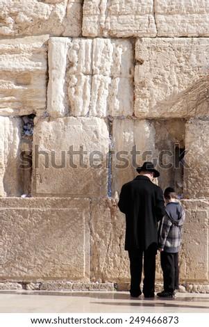 JERUSALEM, ISRAEL - JANUARY 23: Jewish worshipers pray at the Wailing Wall January 23, 2011 in Jerusalem, Israel. - stock photo