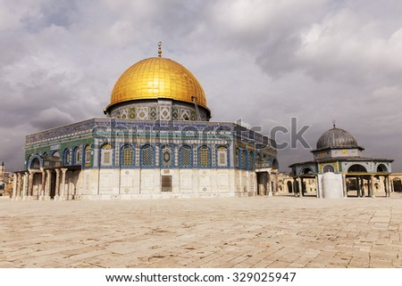 JERUSALEM, ISRAEL - JANUARY 29, 2013: The Dome Of The Rock and the Dome Of The Chain are two of the shrines centered on the Temple Mount in the Old City of Jerusalem.  - stock photo