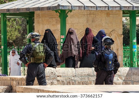 JERUSALEM, ISRAEL - JULY 26, 2015: Palestinian women protest against ascent of jews to Temple Mount during Tisha B'Av - annual fast day in Judaism commemorates destruction of First and Second Temples. - stock photo