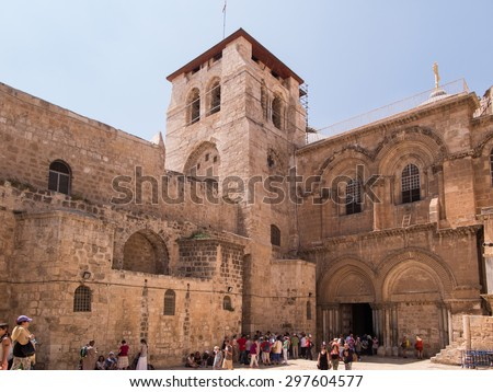 JERUSALEM, ISRAEL - JULY 13, 2015: People at the entrance to the Church of the Holy Sepulchre. July 13, 2015. Jerusalem, Israel. - stock photo