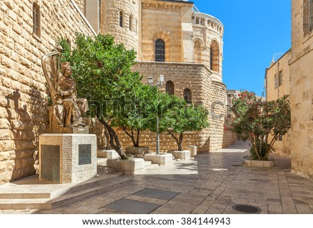 JERUSALEM, ISRAEL - JULY 16, 2015: Sculpture of King David playing harp near entrance to his tomb on Mount Zion. This is also the place believed by Christians of the Last Supper of Jesus. - stock photo