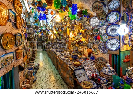 JERUSALEM, ISRAEL - JULY 10, 2014: Typical gift shop with variety of traditional middle eastern handmade souvenirs popular with tourists and pilgrims visiting Old City of Jerusalem. - stock photo