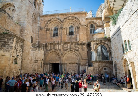 JERUSALEM, ISRAEL - JUNE 1, 2015: People at the entrance to the Church of the Holy Sepulchre. June 1, 2015. Jerusalem, Israel. - stock photo
