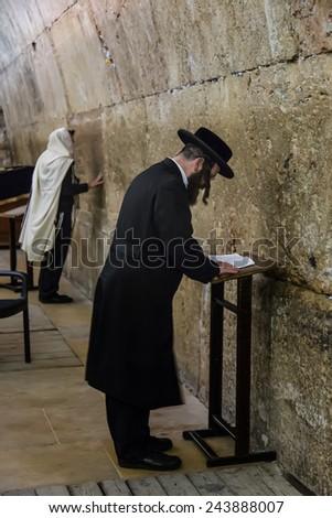 JERUSALEM, ISRAEL - March 20, 2014: A view of Orthodox Jew prayer at Western Wall in Jerusalem, Israel. - stock photo