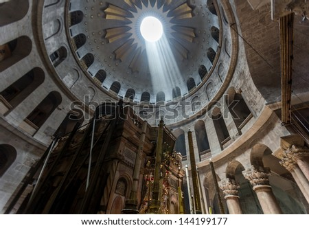 JERUSALEM, ISRAEL - MAY 26: The Church of the Holy Sepulchre is considered the greatest Christian shrine in the world. Pilgrims at the Church of the Holy Sepulchre, on MAY 26, 2013 in Jerusalem - stock photo