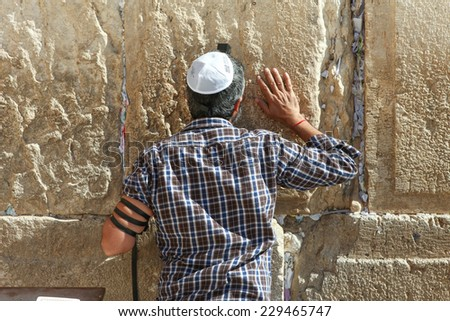 Jerusalem, Israel - November 9, 2014 : A jewish Man pray at the western wall. The western wall is an exposed section of ancient wall situated on the western flank of the Temple Mount. - stock photo