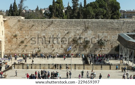 Jerusalem, Israel - November 9, 2014 : Jewish orthodox men pray at the western wall. The western wall is an exposed section of ancient wall situated on the western flank of the Temple Mount.  - stock photo