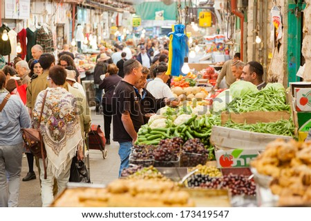 Jerusalem, Israel - November 15, 2012 - people are shopping at Mahane Yehuda - famous market in Jerusalem - stock photo