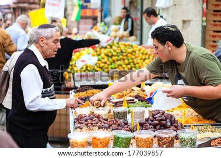 Jerusalem, Israel - November 15, 2012: People are shopping at Mahane Yehuda - famous market in Jerusalem - stock photo