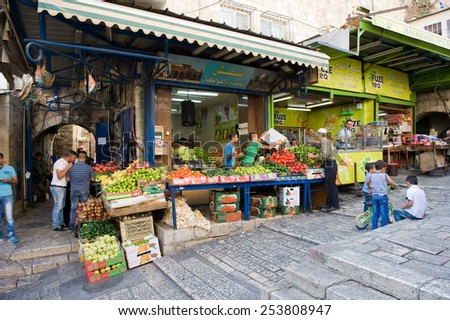 JERUSALEM, ISRAEL - OCT 08, 2014: Fruit  shop in the small streets of the muslim quarter near Damascus gate in the old city of Jerusalem - stock photo