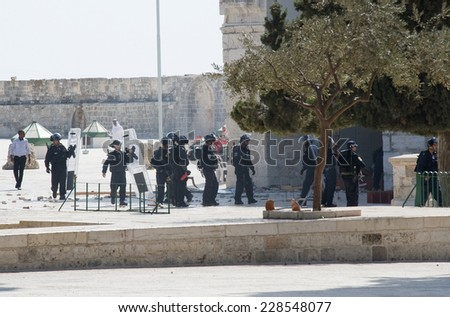 JERUSALEM, ISRAEL - OCT 08, 2014: Israeli police officers in front of the Al-aqsa mosque on the temple-square in Jerusalem after religious fightings with muslims, October 08 in Israel - stock photo
