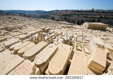 JERUSALEM, ISRAEL - 06 OCT, 2014: Old jewish graves on the mount of olives in Jerusalem - stock photo