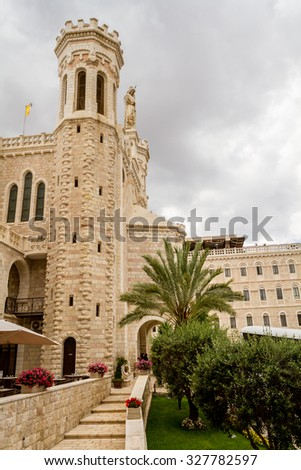 JERUSALEM, ISRAEL - OCTOBER 10: Notre Dame de Jerusalem, part of courtyard in hospice - tower and a statue of the Virgin Mary with Child in Jerusalem, Israel on October 10, 2015 - stock photo