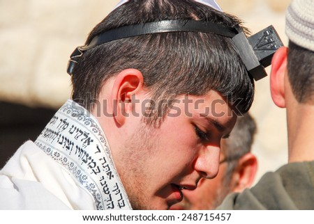 JERUSALEM - JANUARY 18, 2007: Bar Mitzvah ritual at the Wailing (Western) wall in Jerusalem, Israel. - stock photo