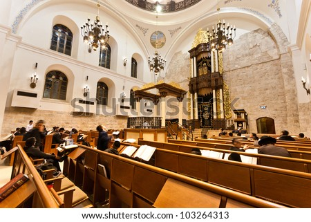 JERUSALEM - MARCH 04: Jewish people pray at the Hurva synagogue March 04, 2012 in Jerusalem, Israel. The newly renovated Hurva Synagogue is the biggest synagogue in the old city of Jerusalem - stock photo