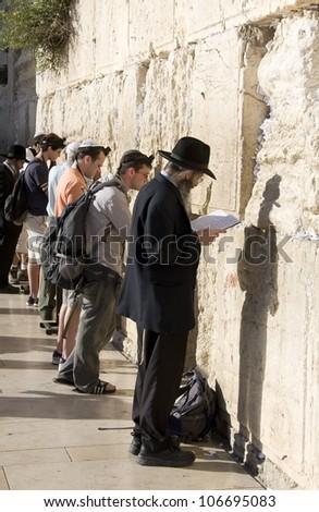 JERUSALEM -MAY 31:  Jews prays at the Western Wall May 31, 2012 in Jerusalem, Israel. - stock photo