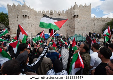 JERUSALEM - MAY 15: Palestinians commemorating Nakba Day at Damascus Gate, East Jerusalem, May 15, 2013. - stock photo