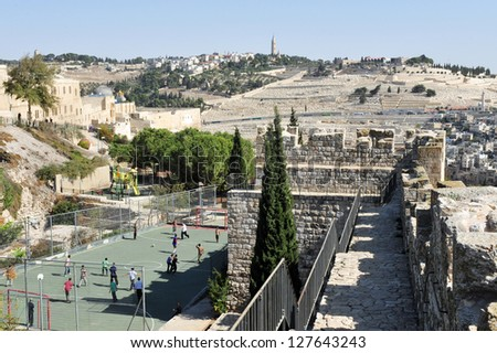 JERUSALEM - NOV 05 2010:Mt of Olives as view from the Jewish Quarter in Jerusalem Israel.It's one of the most important holy sites in Judaism as it believed that it's where the Messiah will trod - stock photo