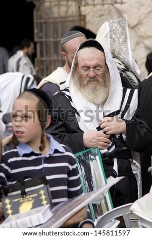 JERUSALEM-OCT 02: Orthodox  Jews  at the Western Wall during Jewish holiday of Sukkot, October 2, 2012 in Jerusalem, Israel. - stock photo