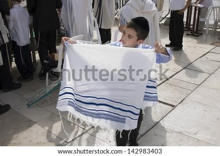 JERUSALEM -October 02: Unidentified boy at the Western Wall during Jewish holiday of Sukkot October 02, 2012 in Jerusalem, Israel. - stock photo
