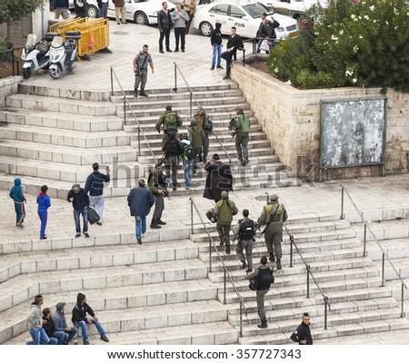 JERUSALEM OLD TOWN, ISRAEL - NOVEMBER 1, 2014: Unidentified Israeli soldiers apprehend terrorist near Damascus gate. - stock photo