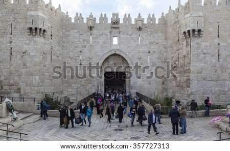 JERUSALEM OLD TOWN, ISRAEL - NOVEMBER 1, 2014: Unidentified people in front of Damascus gate, the entrance to Muslim quarter. - stock photo