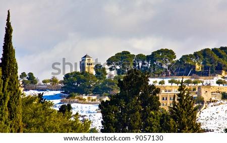 Jerusalem religious landmarks under rare snow (Mount Olives) - stock photo