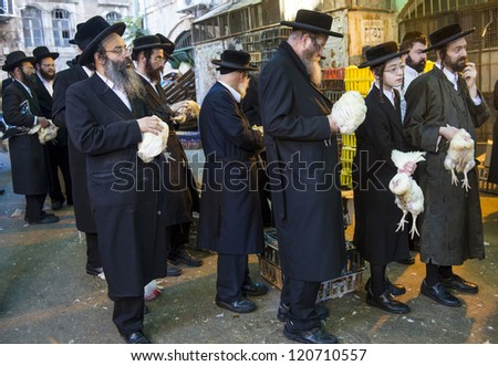JERUSALEM - SEP 25 : An ultra Orthodox Jewish men holds a chicken during the Kaparot ceremony held in Jerusalem Israel in September 25 2012 - stock photo