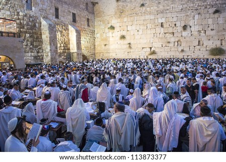JERUSALEM - SEP 25 : Jewish men pray during the penitential prayers the Selichot , held on September 25, 2012 in the Wailing wall in Jerusalem Israel - stock photo