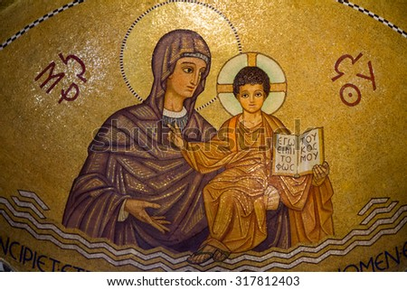 JERUSALEM - SEP 12 2014:Mosaic paint of Mari and baby Jesus at Hagia Maria Sion Abbey church in Mount Zion.According to christian tradition it was the site of the Last Supper and where Mary died. - stock photo