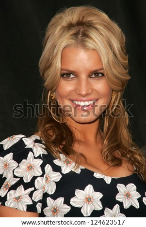 """Jessica Simpson at a press conference to announce Blockbuster Video's """"Total Access"""" Service, Kodak Theater, Hollywood, California. November 2, 2006. - stock photo"""