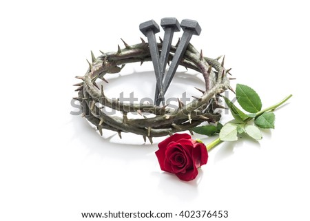 Jesus Christ crown of thorns, nails and a rose on a white background. - stock photo