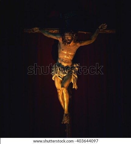 Jesus Christ crucified. Catholic religion symbol.  Christian cross - stock photo