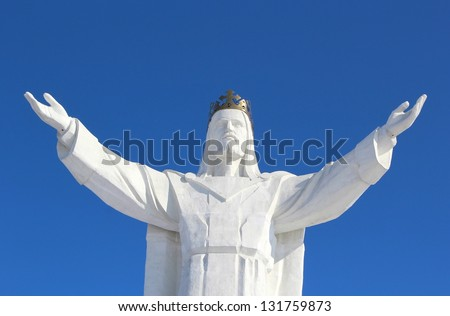 Jesus Christ Monument and Beautiful Blue Sky, Poland - stock photo