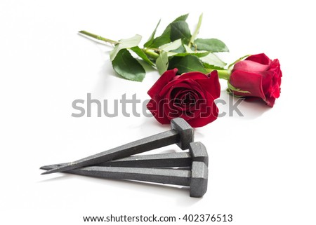 Jesus Christ nails from the Crucifixion and red roses on a white background. - stock photo