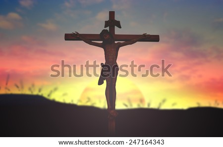 Jesus christ on the white cross over sunset background. - stock photo