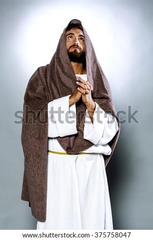 Jesus Christ praying to God  - stock photo