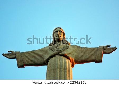 Jesus Christ statue in Almada, Portugal. - stock photo