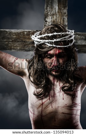 Jesus Christ with crown of thorns white on the cross of Calvary representation - stock photo