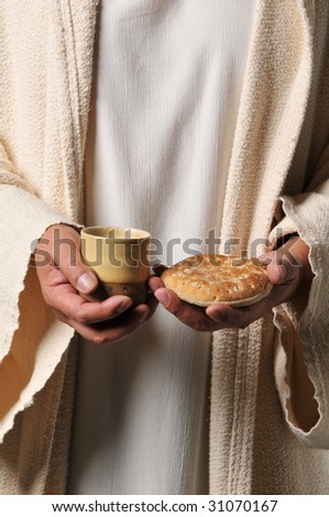 Jesus holding a bread and a wine as a symbol of communion - stock photo